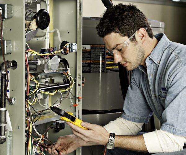 service-technician-testing-a-furnace-155352704-581cac193df78cc2e8803151.jpg